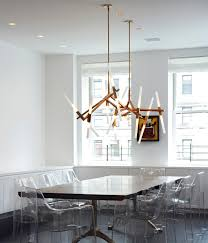he was also the original designer of the oh so popular superordinate antler chandelier the same style can be seen as polished as ever in the roll hill