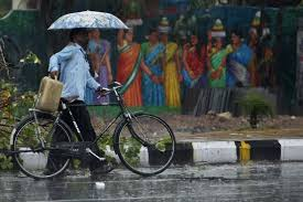 photo essay monsoon rains begin over real time wsj mahesh kumar a associated press a cyclist shared an umbrella a pedestrian as he walked in the rain in the southern n city of hyderabad 29