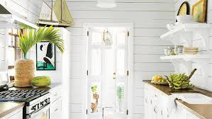 white galley kitchens. Clever Design Tricks Make Even A Narrow Galley Kitchen Seem Roomy.  Homeowner Trish Becker Wisely White Kitchens
