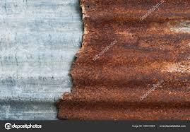 rusty corrugated metal wall rusty zinc grunge style background stock photo