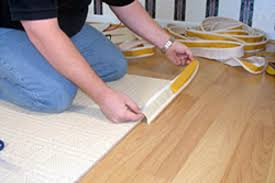 always start in the middle not a corner as it is easier to join two pieces on a straight section l tape and press into the carpet backing as you go
