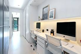 home office furniture for two. Home Office For Two Desk Sits Below A Small Floating Shelf With Hidden Lighting While The Long White Hallway Provides Perfect Space Tucked Away Furniture