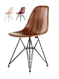herman miller wood chair. the molded plastic chair (or shell chair) that mid-century modern design lovers have grown to covet is epitome of eames process. herman miller wood