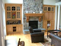 double wall wooden cabinet with classic style on both sides of stone fireplace for living