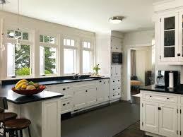 white cabinets dark countertops harbor traditional kitchen white cabinets black countertops gray walls