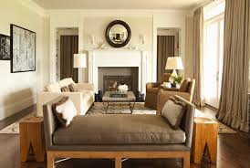 A gray-beige color called Revere Pewter cools the bright light coming  through the big
