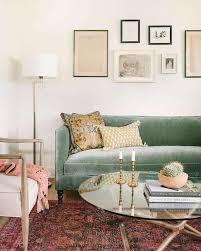 green velvet shelter back sofa with