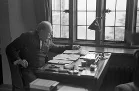 that time winston churchill wrote about aliens in the churchill sits at the writing desk of his country home in 1939