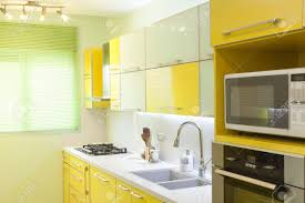Yellow And Gray Kitchen Decor Green And Yellow Kitchen Ideas With Gray Wall And Hanging Lamp
