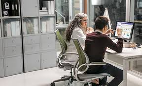 google office pictures. Image Of Two Firstline Workers Collaborating At A Desk In An Office Space. Google Pictures F