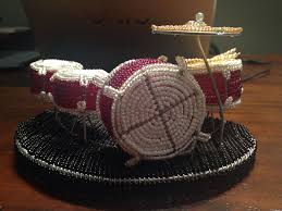 a mini drumkit drumset made out of beads to sit on your table or desk complete with kick drum snare and toms made with white and