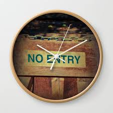 no entry sign hanging on a chain wall