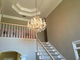 two story foyer chandelier phenomenal what is the best size for a in average decorating ideas