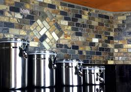 this custom backsplash seen in the above photo is 1 x 2 tumbled slate in a brick pattern the custom inlay was cut out by hand and then pieced in with a