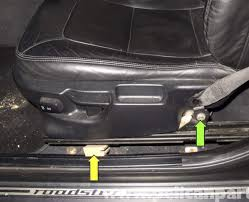 lift side of seat up and tilt toward opposite side of vehicle use a black of wood yellow arrow to hold seat in the position avoid letting seat rest on bmw z3 seat rail bushing