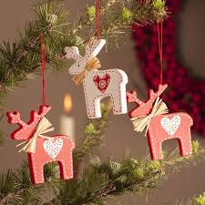 wooden nordic reindeer decoration by the contemporary home    notonthehighstreet.com