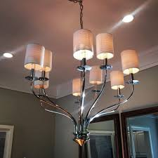 this beautiful chandelier is supplemented by led recessed lighting in the ceiling