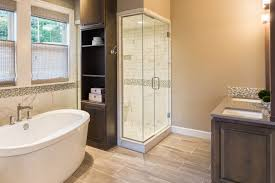 spacious tan and white master bathroom with dark wood vanity i love the built in