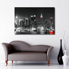 new york city black and white with red splash on black and white with a splash of red wall art with cityscape skyline canvas wall art black sheep design