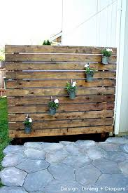 wooden pallets used in a vertical green wall