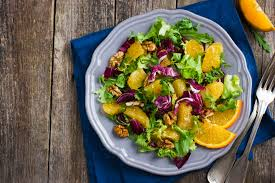 salads are a year round healthy addition to any table and who says citrus fruits are only for summer this combo of greens with gfruit and orange