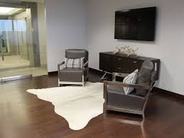 interior faux zebra hide rug with chair and white round table on