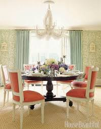 the white chairs and c chandelier make a big gany table feel lighter than it is says designer ashley whittaker