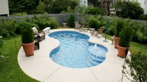 Small kidney shaped inground pool designs for small spaces