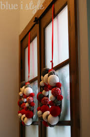 the panes of glass my favorite way to hang a wreath is from a long ribbon that is secured to the top edge of the door using a flat head thumb tack