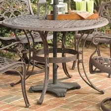 48 inch round outdoor patio table in rust brown metal with umbrella dining decor 7