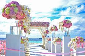 beach beach wedding chairs clouds daylight decor decorations event flower bouquets flowers island landscape ocean outdoors resort sand sea