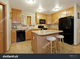 Light Colored Kitchens Light Color Kitchen With Black Appliances Stock Photo 69717871