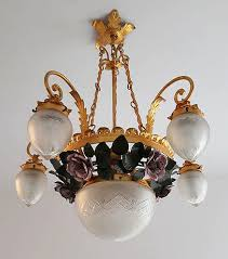 chandelier realised by baglini chiavari in wrought iron and gold leaf decorated with a fl motif roses fl pattern with roses with five