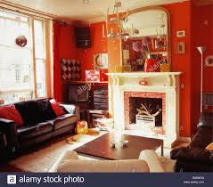 Of Living Rooms With Leather Furniture Brown Leather Sofa Below Window In Red Living Room With Large