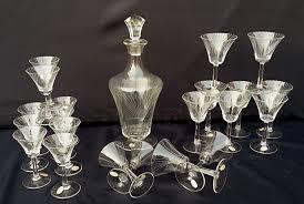 set of 11 liquor glasses 10 whisky spirit glasses 1 bottle with a
