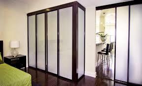 milky glass sliding closet doors with black frame finish