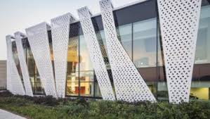 modern office exterior. Decorations: Creative Design Glass Facades Office Exterior With Dark Lighting In Interior And Green Park Modern R