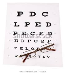 Pair Reading Glasses Laid Across Stnadard Stock Photo Edit