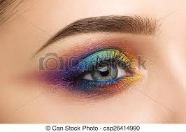 close up of woman eye with beautiful colourful makeup csp26414990