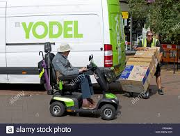 Yodel Design Yodel Delivery Van And Mobility Scooter England Uk Stock