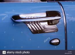 1950s art deco style door handle of vine antique clic car metallic silver and blue graphic design outdoor