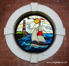 stained glass swan pattern round porthole window