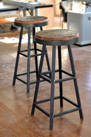 Hand Made Reclaimed Barnboard & Custom Raw Steel bar stools by Ron Corl  Design Ltd |
