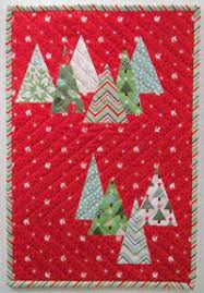 14 Christmas Tree Quilt Patterns | FaveQuilts.com & Christmas Tree Farm Wall Hanging Adamdwight.com