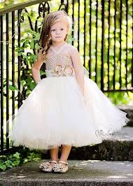 lace tutu flower girl dress accessorized with golden roses