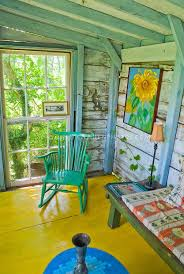 brightly painted wood furniture porch wood beams bright paint rocker rocking chair bright painted furniture