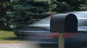 Red Flag Mailbox Mailbox With Heavy Traffic Focus On A Black Mailbox