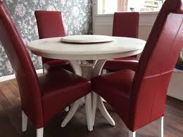 dining table and chairs round cream table red leather chairs