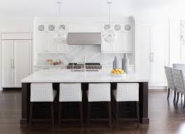white kitchen with brown island illuminated by cyan design j large 1 light globe pendants