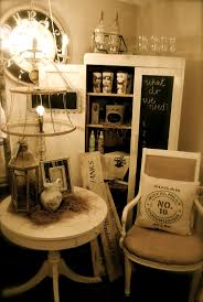 great display piece with chalkboard door, good piece for storing candles,  frames. Like the bare bone lamp shade too